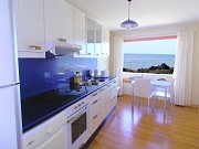 Kitchen with sea views